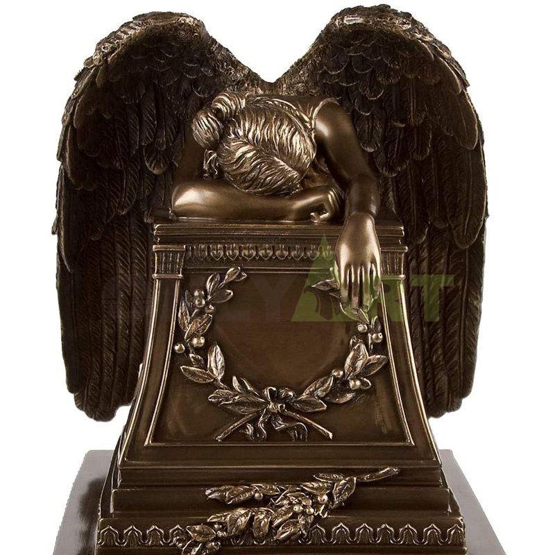 A bronze statue of a quiet little angel