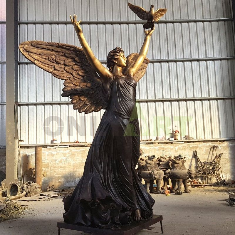 A sculpture of an angel bathing in the sun