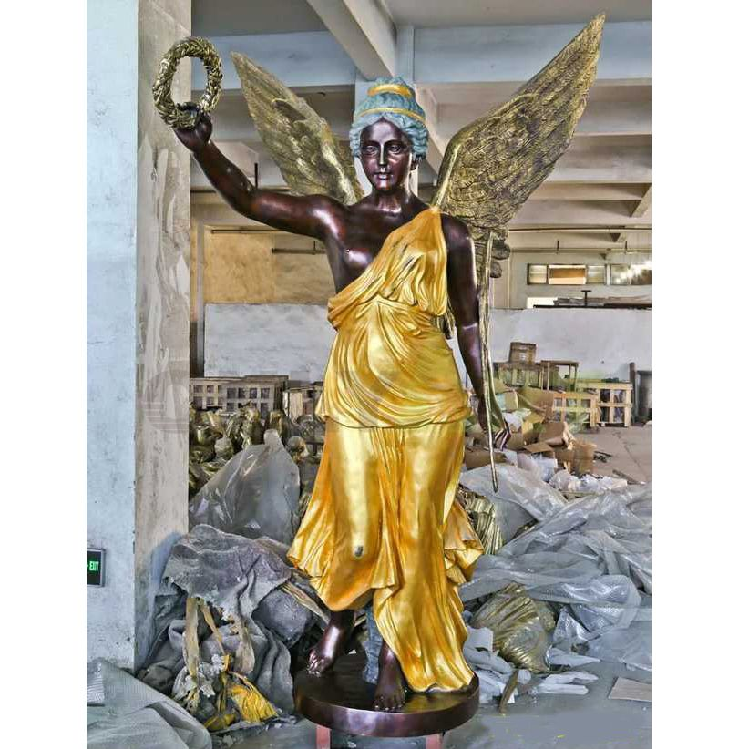 A bronze statue of the blessing of a religious girl angel