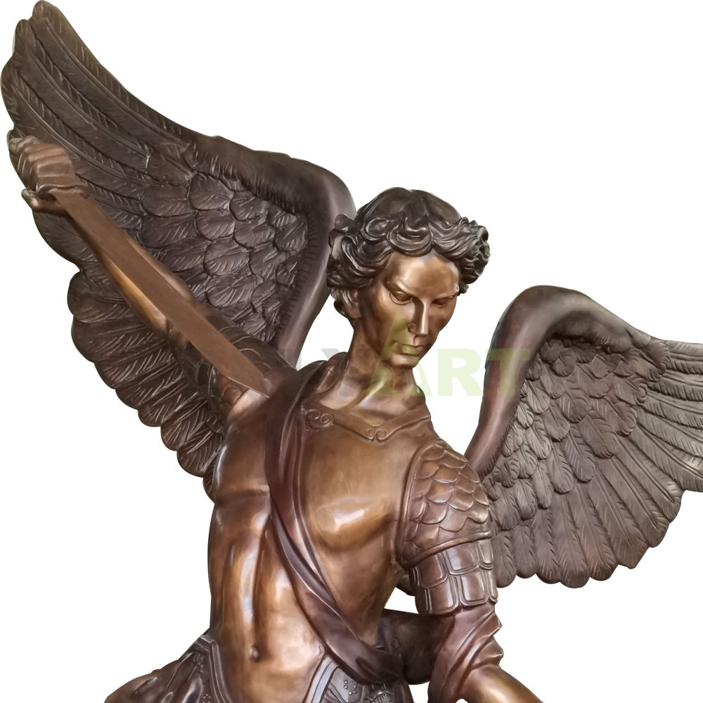 A statue of an angel holding a sword to subdue a demon