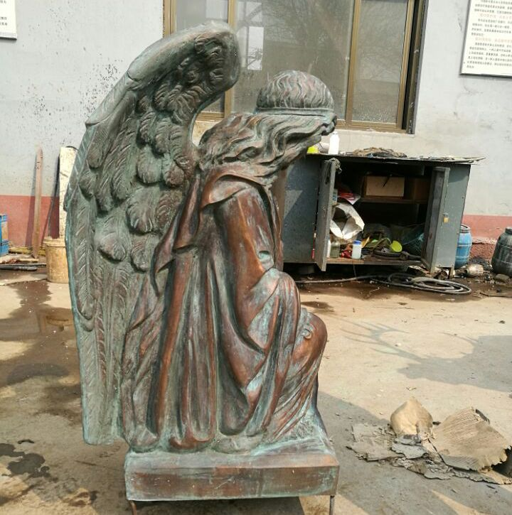A brooding statue of a Nun's Angel