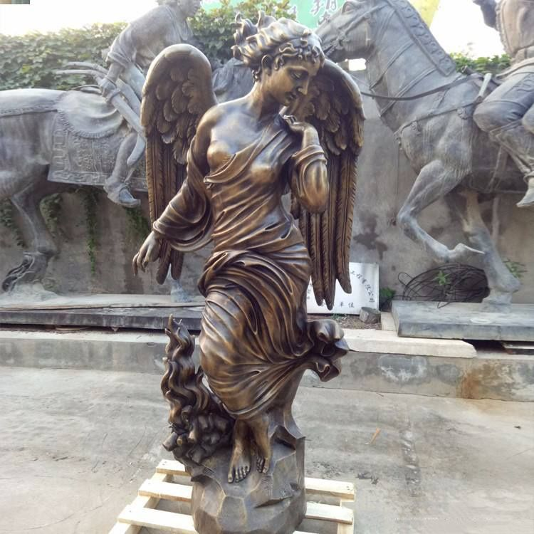 Elegant sculpture of a female angel with her wings closed