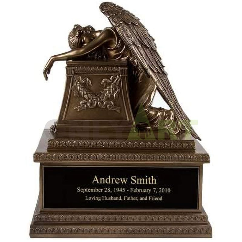 The popular hand-made bronze angel of hell is decorated with mourning statues