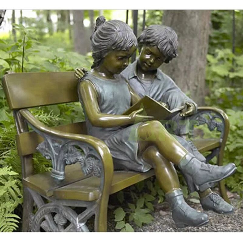 Boys and girls reading together, children sculpture