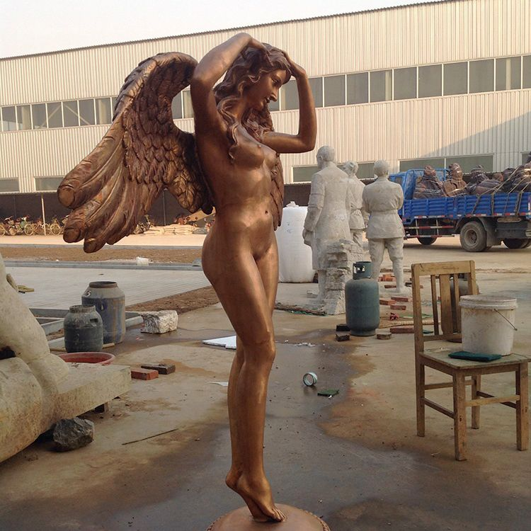 The bronze sculpture of the body of a confident angel