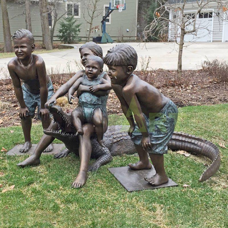 Children with crocodiles, children sculptures