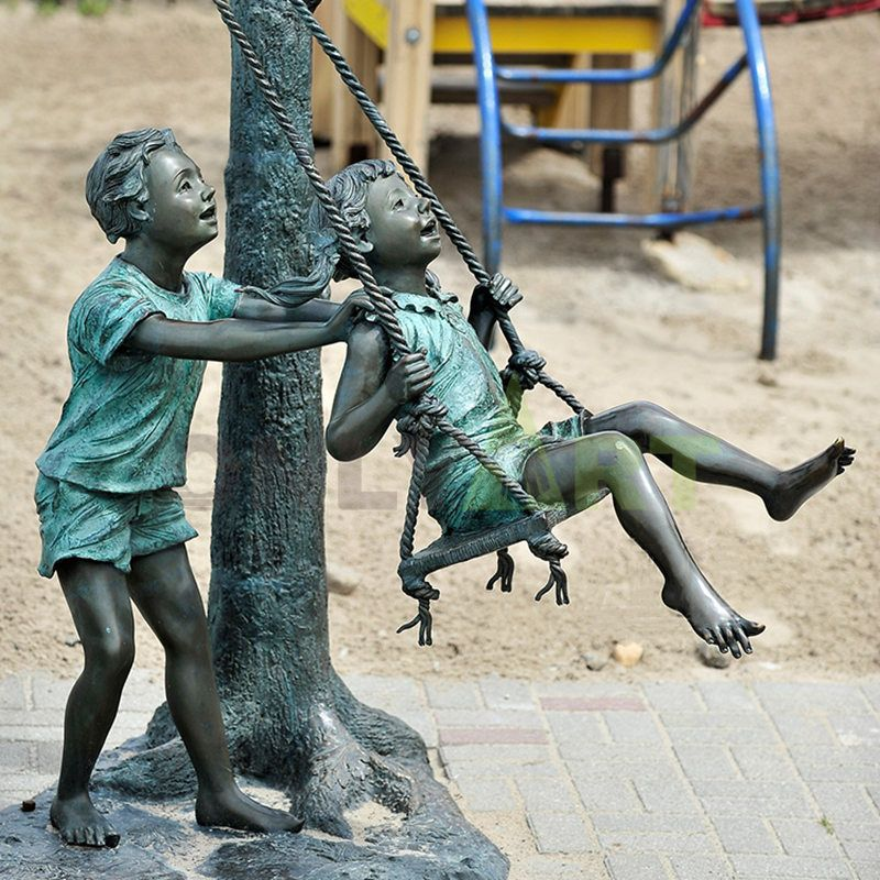 The boy played on the swing with another child