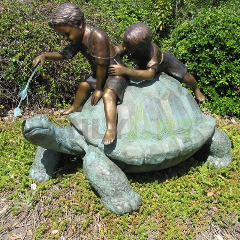 Two children were playing with the turtle on its back