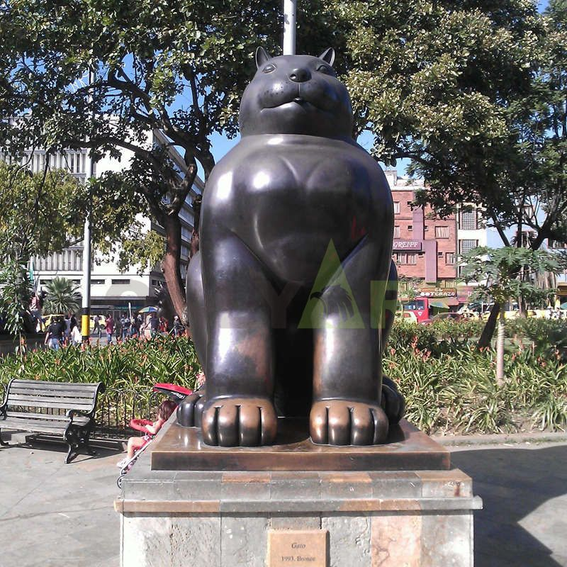 Standing fat cat looking straight at you sculpture