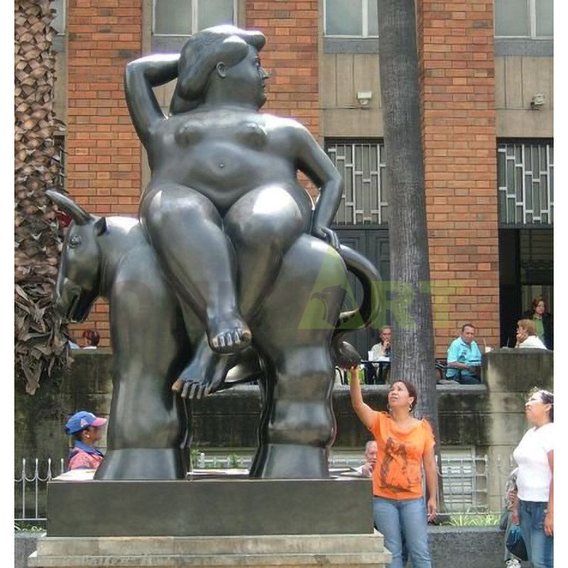 The giant fat girl and her cow are in the square