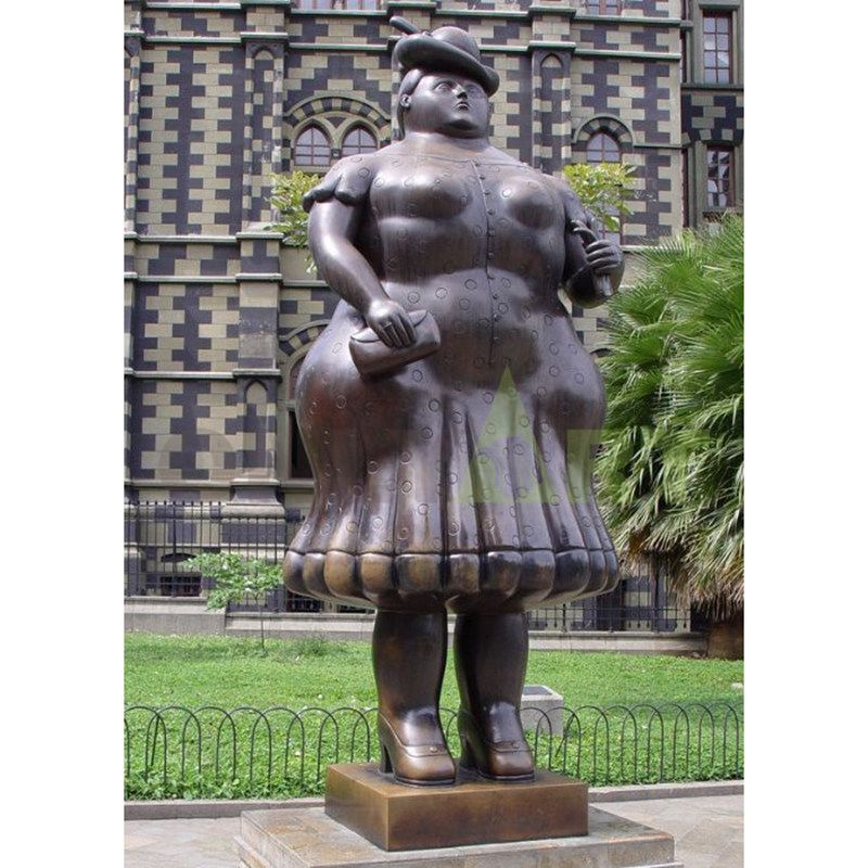 The fat girl was standing in the central square in a pretty skirt