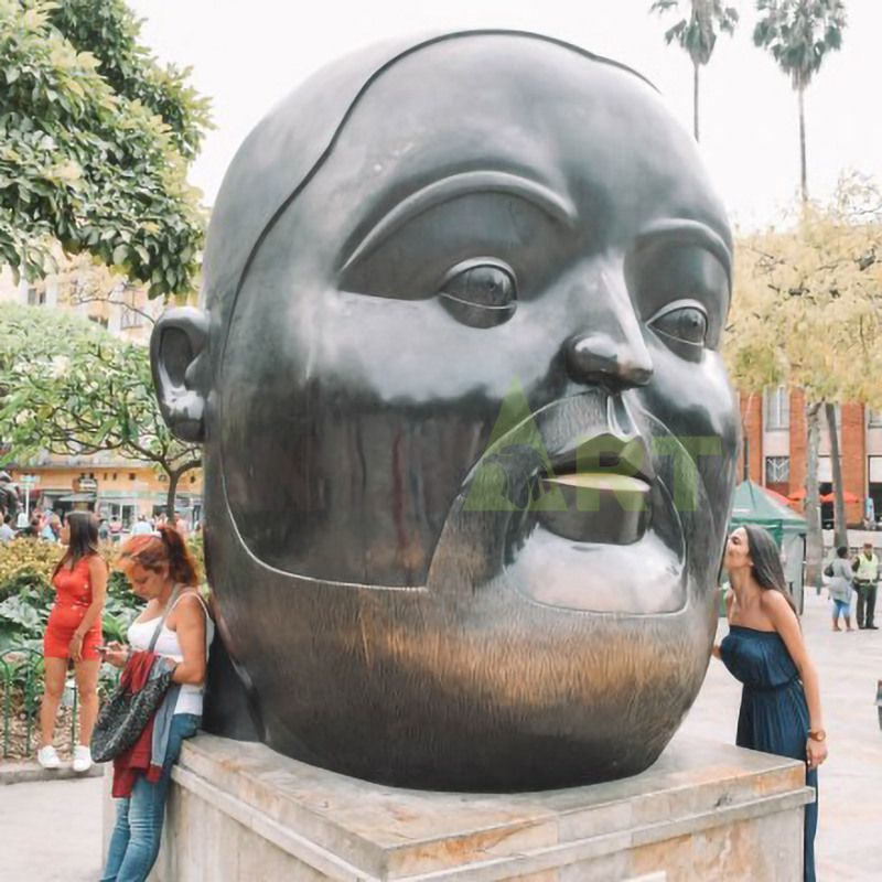 Sculpture of a bearded man with a large face