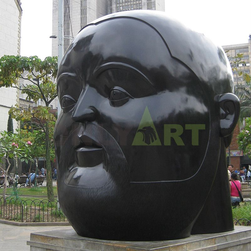 Sculpture of a large black man with a flat head and a fat face