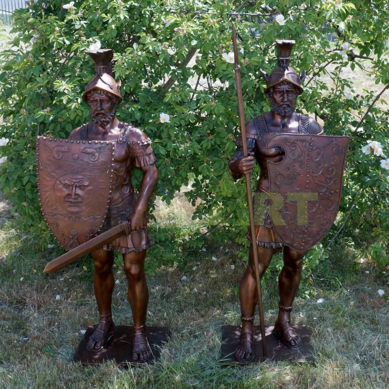 Two life-size bronze statues of Roman warriors