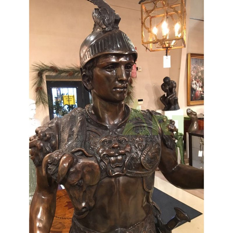 A life-size bronze statue of a Roman warrior carrying a shield and spear
