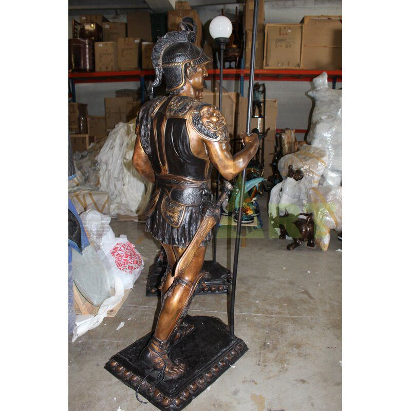Ancient Roman sculpture of a serious warrior holding a lamp