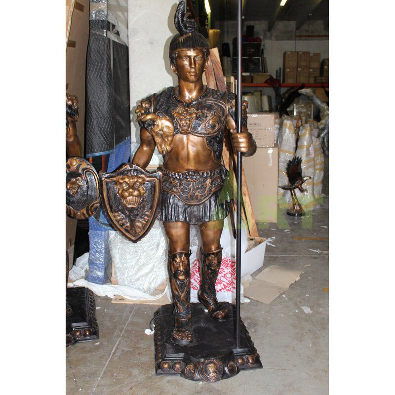 A statue of a Roman warrior with his head hidden