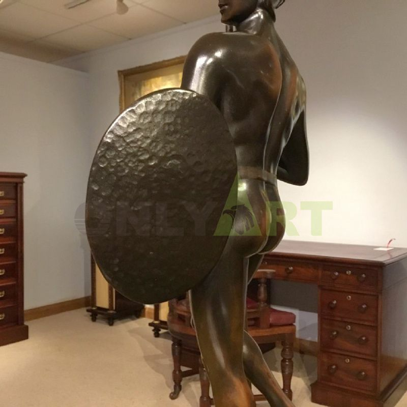 Sculpture of the back of an ancient Roman soldier holding a shield