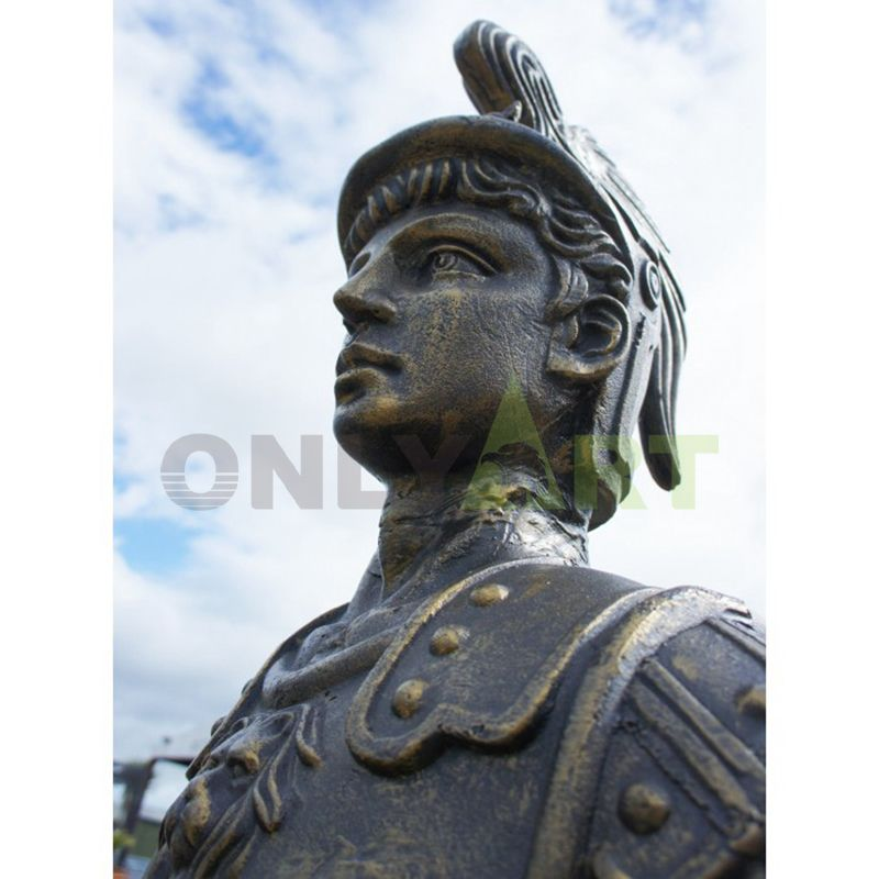 The bust of a Roman warrior against the blue sky
