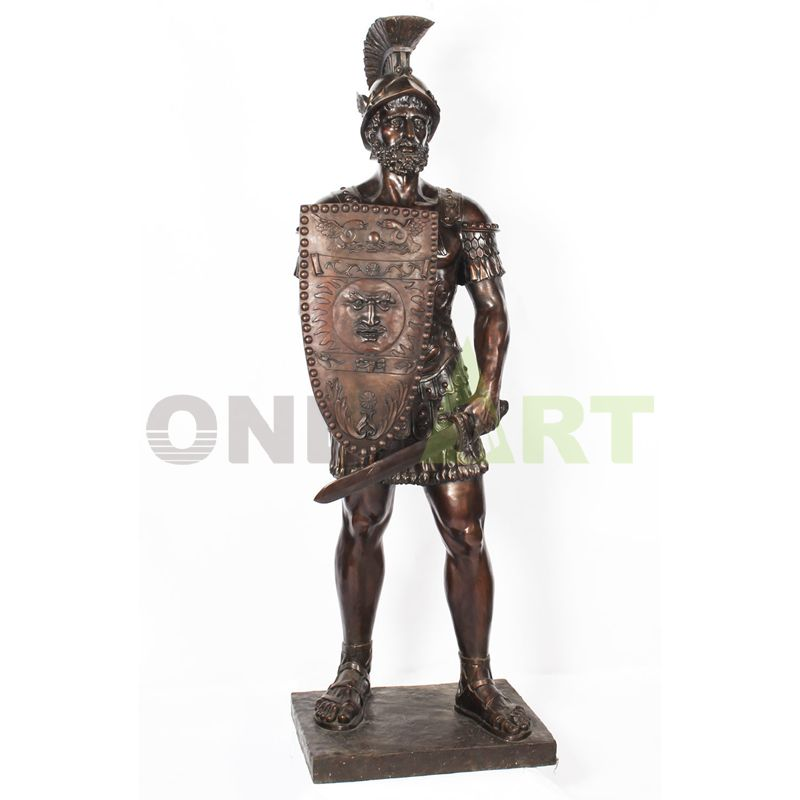 A statue of Leonidas with a gun on its shoulder