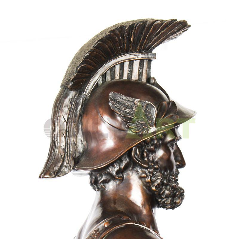 Sculpture of a Roman warrior holding a sun-patterned shield
