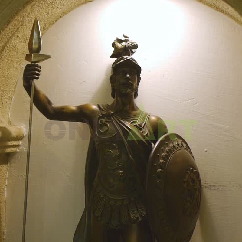 A Roman warrior squatting on a platform