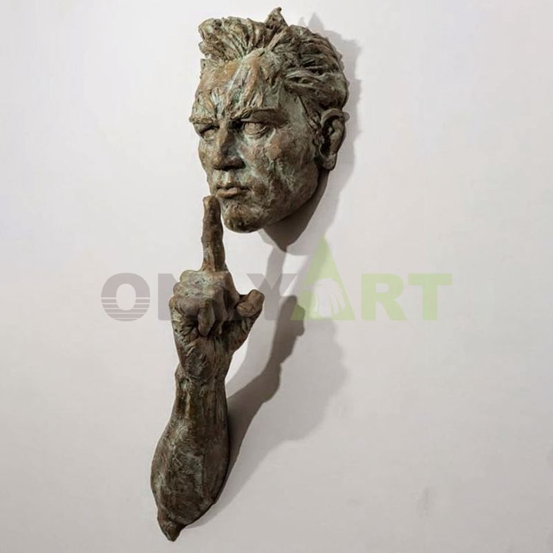 An abstract sculpture of Mateo Pugliese attached to a wall