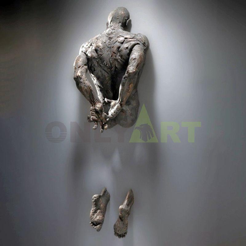 Bronze abstract nude man sculpture Matteo Pugliese on wall statue