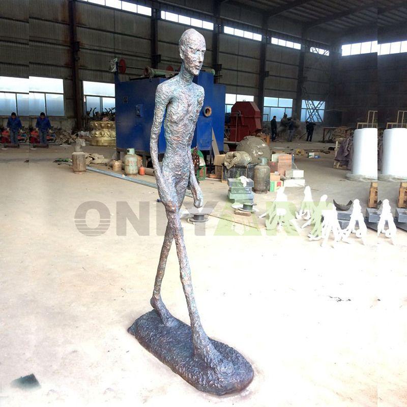 A scrawny walking man alberto giacometti sculture
