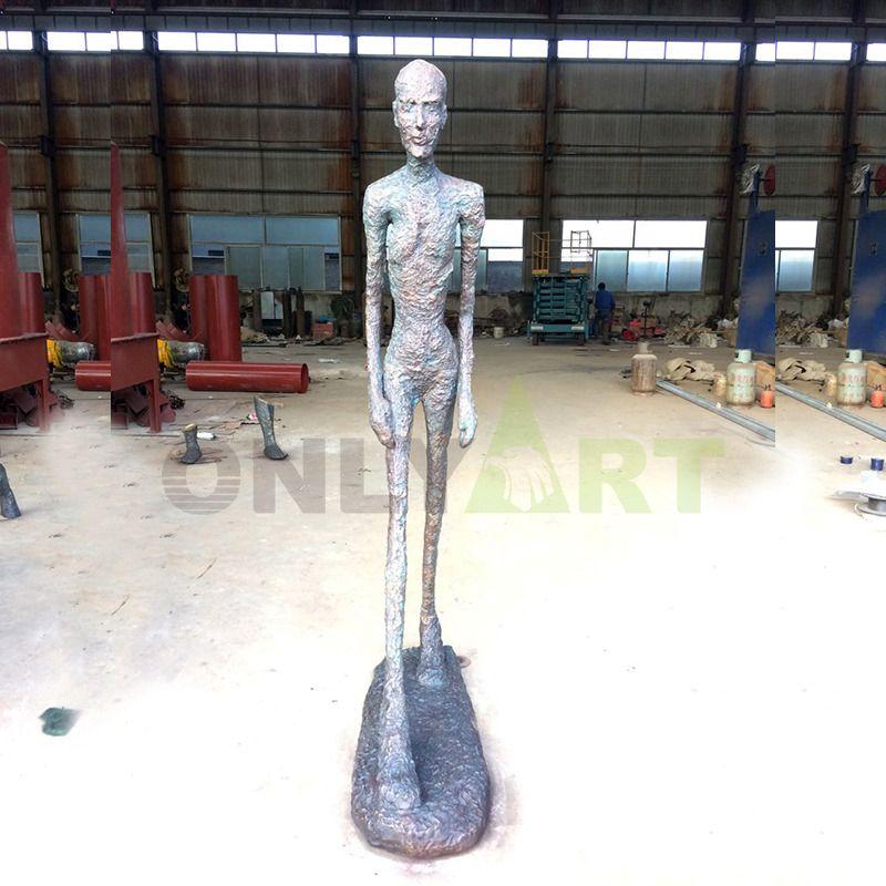 Bronze sculptures of raised bumps, men walking