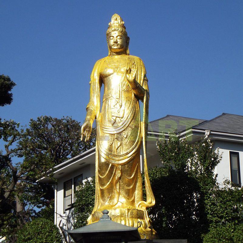 Outdoor large standing golden bronze life size Thai buddha statue