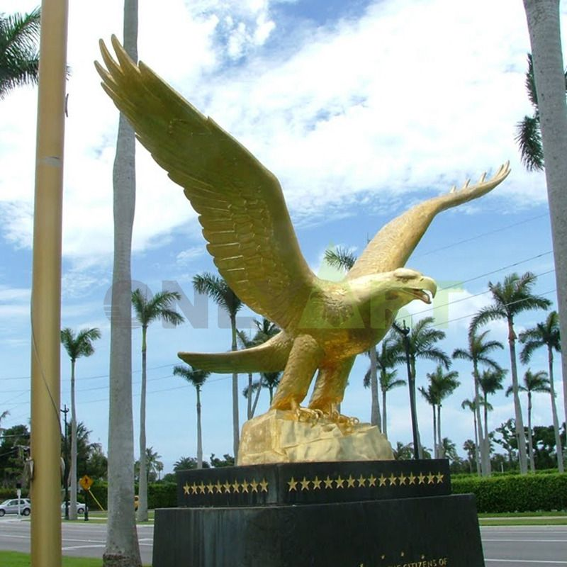 Outdoor brass animal sculptures spread wings and soar eagles