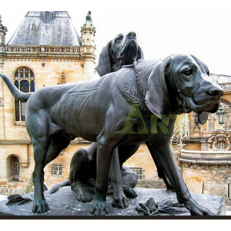 Outdoor sculpture of two strong middle-aged dogs