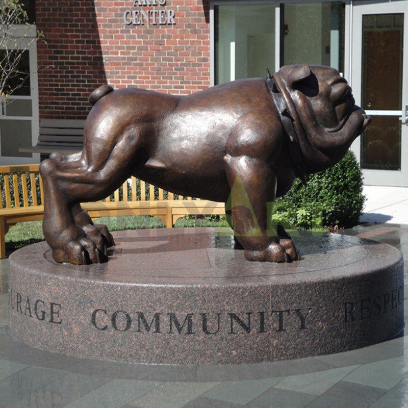 A large, muscular bulldog sculpture
