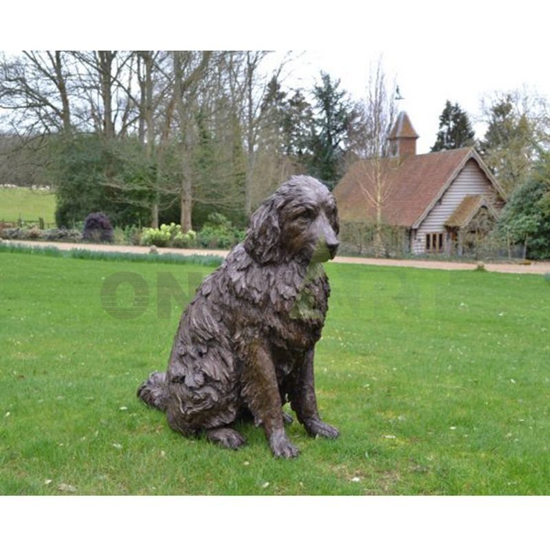 A sculpture of a golden retriever in front of the cottage on the lawn