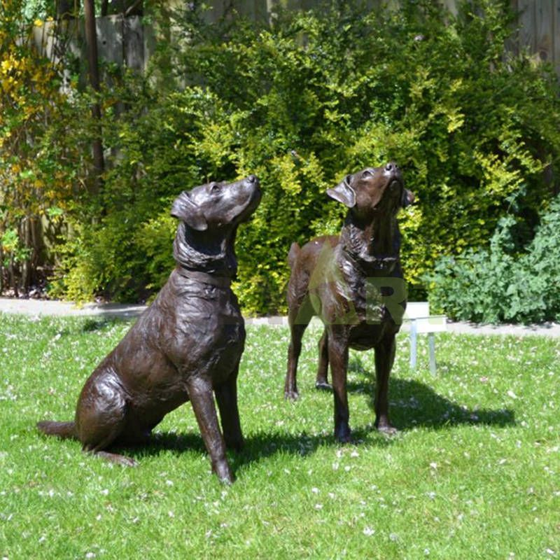 Look up at the sculpture of two Doberman pinschers
