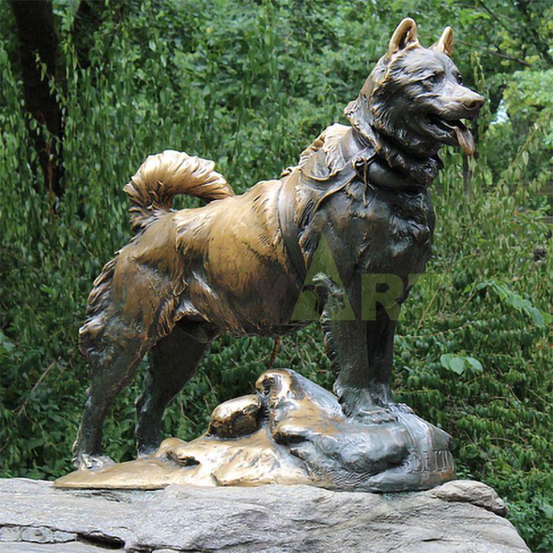A lifelike bronze sculpture of a Doberman Dog in the jungle