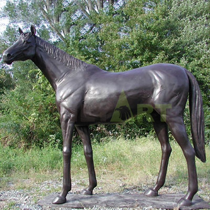 A statue of a quiet mane horse with its head tilted