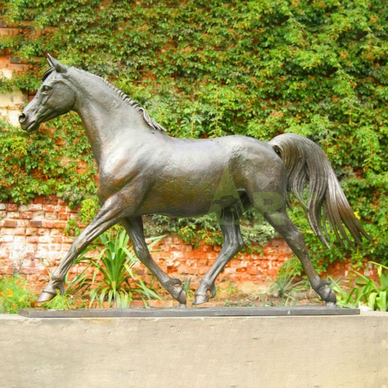 A statue of a weary horse on his way