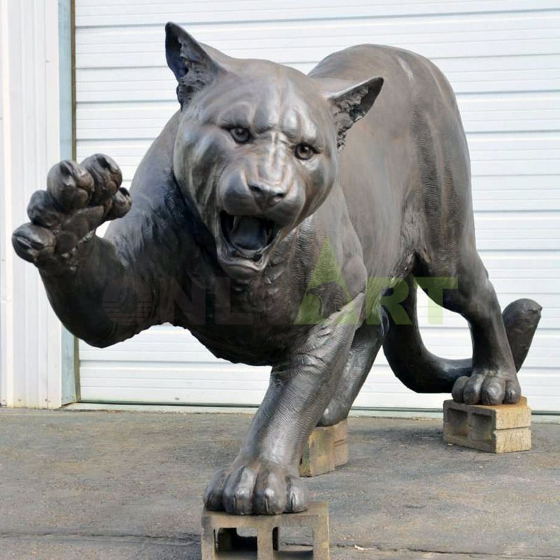 Custom abstract jaguar reaches out to grab the magic sculpture