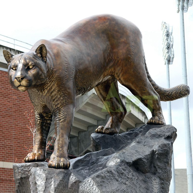 A custom-made bronze statue of a leopard that stands menacing on a rock
