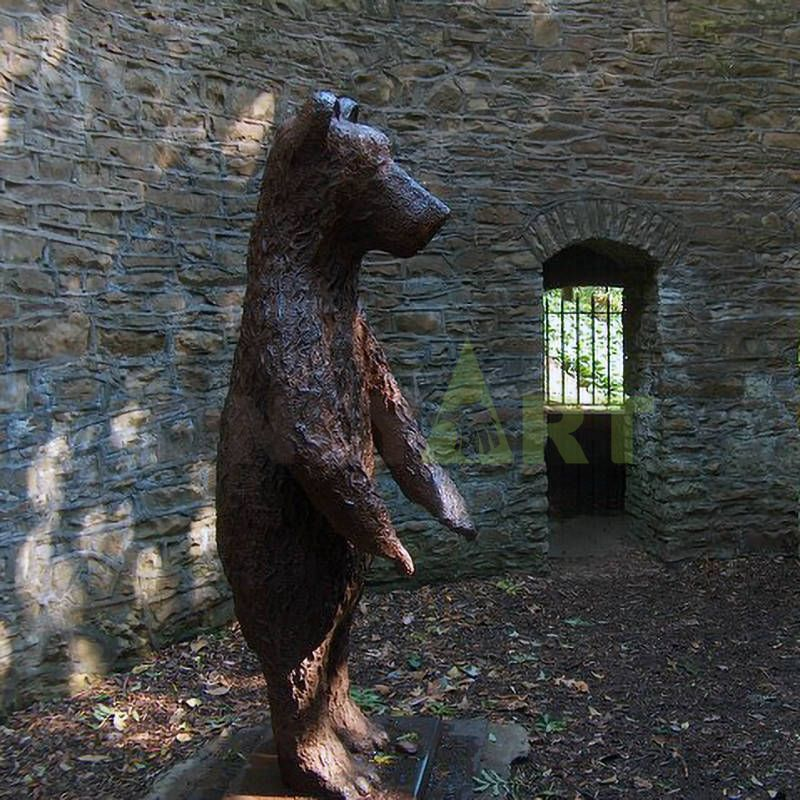 Little bear cubs with their mother in a bronze sculpture