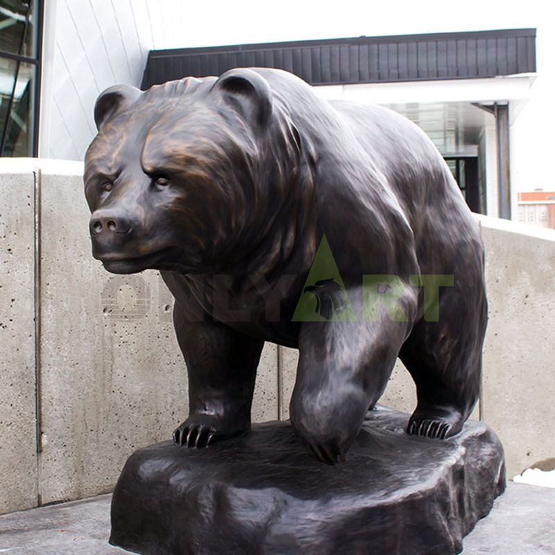 A bronze sculpture of a beautiful woman and a brown bear family