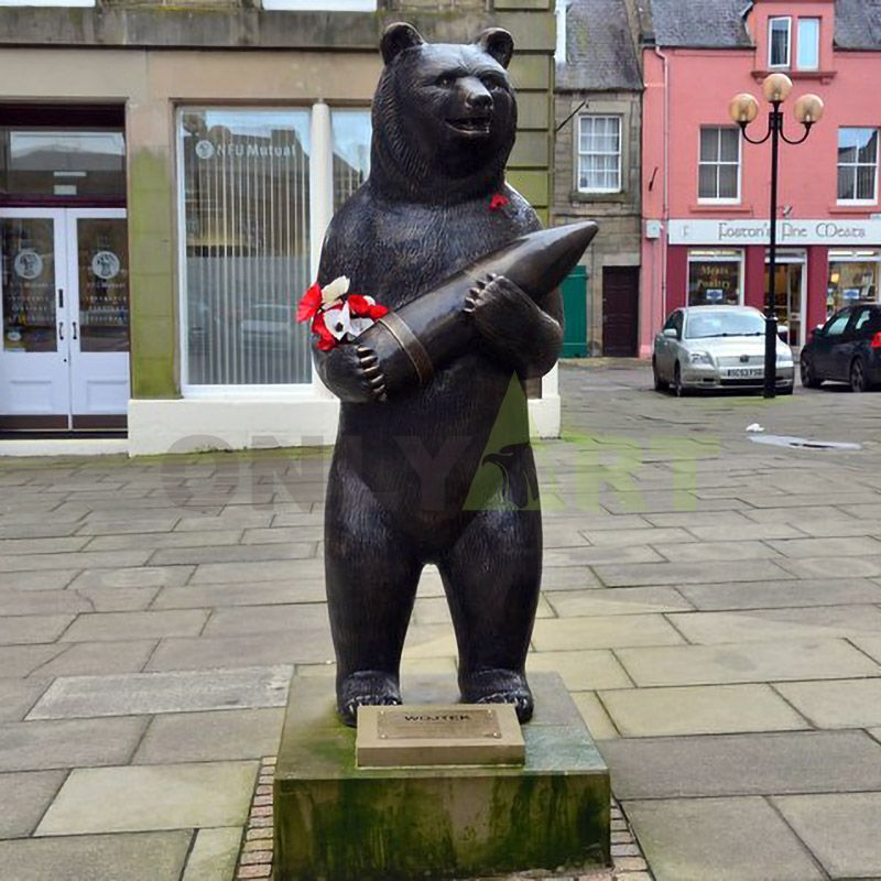 The bear stands with a bronze missile in his arms
