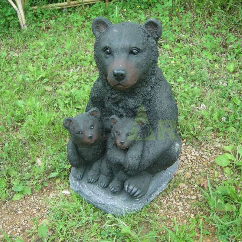 Mother Bear is sitting with baby bear on the lawn