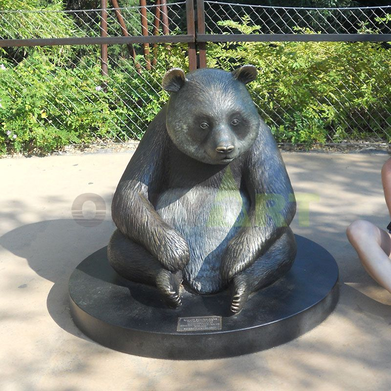Bronze bear sculpture, panda holding a stone