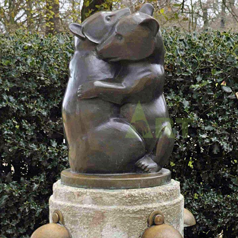 A sculpture of polar bears hugging each other