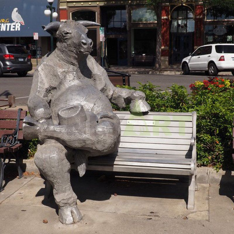 Bronze bull sitting on a chair