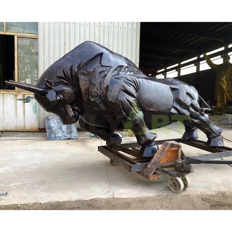 An abstract sculpture of a large exaggerated figure with a small head of bronze bull