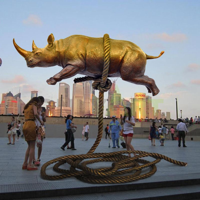 A golden rhinoceros tied to a magic rope